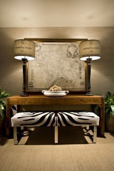 Love the vintage map and lamps with the modern zebra bench seat