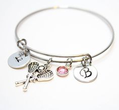 ~~~~~Lacrosse initial bracelet features~~~~~   Stainless steel bangle and components. Will not tarnish or rust. Fits wrist size small/medium, but it will expand to a larger size. 22mm lacrosse charm  12.5mm aluminum hand stamped initial disc  12.5mm aluminum hand stamped number disc  6mm Swarovski Channel birthstone  INFORMATION I NEED: When you go to checkout, there is a section for notes to seller. Please put the number you would like there.     ~Bangle(s) will come in a pretty box wit...
