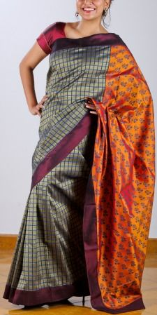 Who said grey is boring? Definitely not when it is teamed with a maroon border and a flame orange block printed pallu.The blue and black of the checkered body of the saree join hands with the blue  and black floral motifs on the pallu making it a very interesting piece that is suitable for all age groups. SHOP AT www.ubikaa.com
