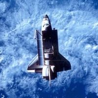 Space Shuttle Challenger pictured in orbit with cargo bay open allowing it to collect solar power Challenger Explosion, Space Shuttle Challenger, Nasa Space Program, Rhapsody In Blue, Our Solar System, Space Station, Space Travel, Space Exploration, Space Crafts