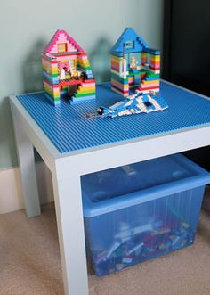Organized Lego's - small white side table from IKEA with four blue Lego bases glued on top & a bin underneath.