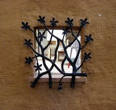 if you are going to do wrought iron on your windows, this is the way to do it.