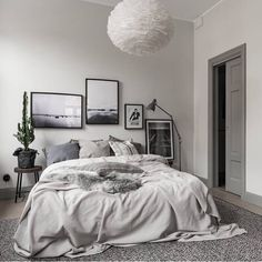 A beautiful grey bedroom styled by @scandinavianhomes, Eos lamp is perfect for any bedroom, available at www.istome.co.uk
