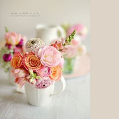 This pink/peach flower arrangement in a mug is absolutely stunning! what a great, budget friendy flower arranging idea! Photo by Sarah Gardner