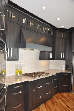 Fabulous kitchen design with black cabinets | Remodelaholic