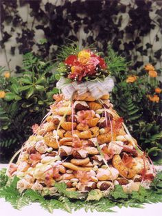 Italian wedding cookie cake - very traditional in Southern Italy.  You can have it in addition to a traditional wedding cake - you could have your grandmothers make cookies.....