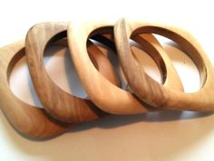 Beautiful wooden bangle in a flat, square shape. Carefully hand sanded then rubbed in beeswax to retain that lovely, natural wooden look. Please note you are purchasing one bangle. Handmade Wooden, Handmade Crafts, Craft Shop, Wooden Jewelry, Handmade Bracelets, Bangles, Texture, Woodcarving, Gold