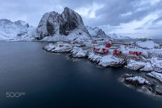 The beautiful cabins at Hamnøy outside Reine in Lofoten, Norway. If you look carefully you can see mighty chain of mountains going off into the horizon. Lofoten, Winter Scenes, Beautiful Images, Norway, River, Mountains, Outdoor, Outdoors, Winter Scenery