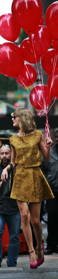This was IN NYC- and it was all over- what was T.S. doing & where was she going with all those balloons? LMAO..And we thought the RED Tour was over. ..