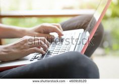 Young woman using computer laptop for online learning or business contact.