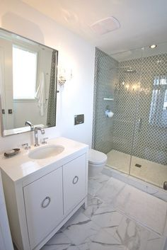 large Carrerra flooring, moroccan shower...love the simple cabinetry