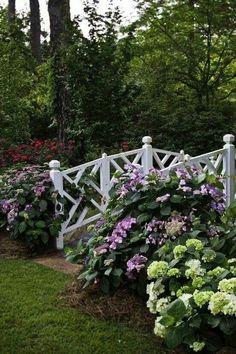 White Footbridge with hydrangeas