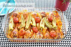 Fırında Patatesli Tavuk But Tarifi - Malzemeler : 10 adet tavuk baget, 4 adet orta boy patates, 2 yemek kaşığı sıvı yağ, 6-7 adet yeşil biber, 6-7 adet cherry domates, 1 yemek kaşığı domates salçası, 1 tatlı kaşığı kırmızı tatlı toz biber, 2 adet domates 1 su bardağı su, 2 yemek kaşığı sıvı yağ, Tuz.