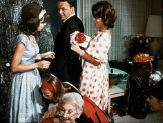 Frank Sinatra celebrating Christmas at home with daughters Nancy and Tina