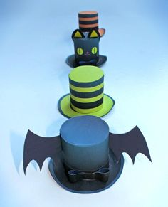 4 fun and not too scary Halloween mini paper top hats to download for a party or class activity.!