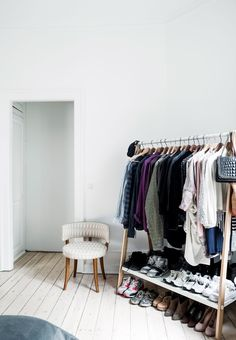 Pretty clothes rack in the wardrobe with a practical shelf for shoe storage.