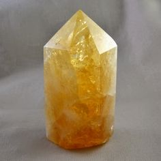Citrine crystal point. Citrine is helpful for digestive problems, and can assist the stomach, spleen and pancreas.