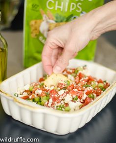 ~ fresh Greek dip ~ crumbled feta, chopped tomatoes, chopped olives, olive oil, and chopped green onion ~ use pita chips to scoop it up ~ can add some chopped olives ~
