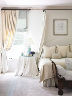 Drapery panels over roman shades, on iron rid with finial, adjacent to a return rod for bed hangings. Layers of faint colors create a peaceful environment. Beth Webb, Interior Design