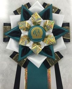 View our collection of ribbons and rosettes available in accents including floral, patterned, glittery golds, silvers and more. Ribbon Rosettes, Ribbons, Centaur, Garter, Sash, Festivals, Homecoming, Photo Galleries, Arts And Crafts