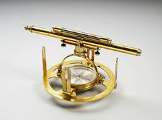 An early 18th century brass Altazimuth theodolite, signed T. Heath Fecit.    The silver compass dial is finely engraved with pointers to the North, South, East and West. The inner circle is divided in four quadrants, the outer 0º-360º.