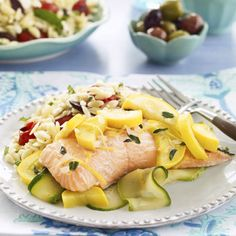 "Salmon and Summer Squash in Parchment: ""This party-appropriate salmon and squash dish is baked in parchment paper, which seals in the flavors and makes cleanup easy. Easy Salmon Recipes, Fish Recipes, Seafood Recipes, Cooking Recipes, Healthy Recipes, Healthy Foods, Fish Dishes, Seafood Dishes, Main Dishes"