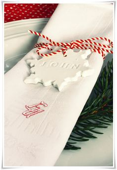 make place-cards with baking clay, cookie cutters & letter stamps, simple & lovely. #christmas #table