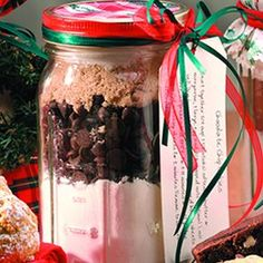 Possible Favors in little mason Jars- Hot Chocolate mix, Marshmallows & Chocolate Chips... Covered top with red & white Polkadot Fabric & Blue or Green Ribon to tie...PRICECHECK! :)