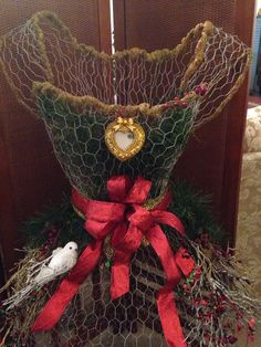 Chicken wire dress form, dressed up for Christmas, by Laura Collins