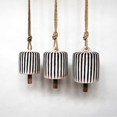 Wide Thrown Bells, made of Stoneware with Shino Glaze, are assembled on 6' of hemp rope with a knocker made from reclaimed walnut. Michele Q...