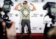 Ludacris roared and flexed for the cameras at the Tribeca Film Festival premiere of SNL documentary Live from New York!, held in NYC April 15.