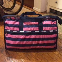 """LeSportsac Large Weekender-NEW I am a huge LeSportsac fan, but I'm realizing there are only so many of these bags I can really own and expect to ever use! I love the rugby stripe print of this one (no longer available from LeSportsac!), but I'm just not really a pink person and thus haven't ended up using it! Perfect condition inside and out. Oh--and in case you're not familiar with the """"Weekender,"""" I think you can fit more than just a weekend's worth of stuff in here! I can easily pack for…"""