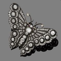 An antique ruby and diamond butterfly brooch, the body set with cushion-shaped diamonds, the wings with similarly, single and rose-cut diamonds, the head highlighted with two circular cabochon ruby eyes. Insect Jewelry, Butterfly Jewelry, Bird Jewelry, Animal Jewelry, I Love Jewelry, Gemstone Jewelry, Silver Jewelry, Jewelry Design, Butterfly Art