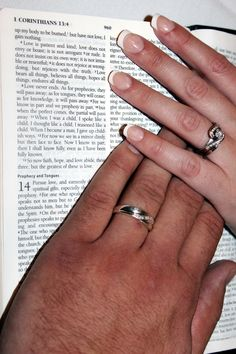 Hands with wedding bands on Bible page. A picture I took at a wedding recently. I definitely want to change the lighting