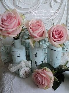 Shabby chic white bottles with pink roses