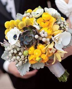 bouquet of ranunculuses, anemones, silver brunia, dusty miller and orchids