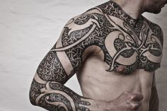 fleursmasculines:  http://www.torildartistes.com/blog-2/inspiration/   Beautiful use of negative space in this tribal tattoo. Nice chest too...