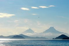 Four Clouds and a Pair of Volcanoes by NaturalLight, via Flickr