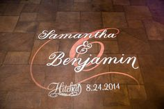 The Hitched Wedding Lighted Monogram on Happy Days Lodge's stone floor by Something New Entertainment.  http://www.SomethingNewEntertainment.com