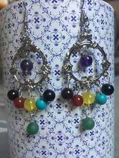 A personal favorite from my Etsy shop https://www.etsy.com/ca/listing/481351487/7-chakra-stone-earrings