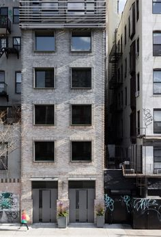This Manhattan apartment block has a facade made up of multi-tonal brickwork, zinc panels and metal louvres