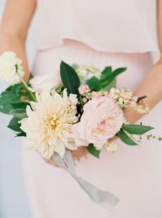 bridesmaid bouquet | rose and dahlia bouquet with berries and greenery | Whimsical Ranch Wedding in Texas