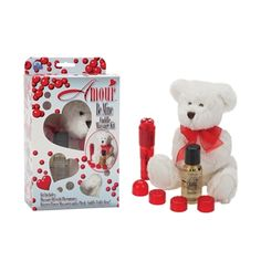 PLUSH TEDDY BEAR THAT HOLDS A NAUGHTY SECRET A POWERFUL POCKET ROCKET VIBRATOR WITH 4 INTERCHANGEABLE CAPS AND A PHEROMONE MASSAGE OIL.