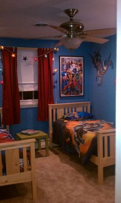my Jaden would love this room he loves super heros and the great thing about it is they peel  right off the wall so when he grows out of superheros we won't have to repaint