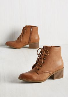 After setting out in these cognac brown booties, you have a new outlook on your city. Every fountain seems like a lake worth admiring and every shop a new country to explore. So, click the stacked heels of these boots, dust off their faux-leather finish, and embrace exploring your town anew!
