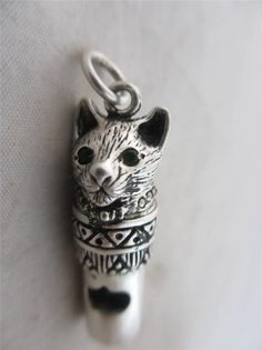 http://www.ebay.com/itm/ANTIQUE-c1920-ART-DECO-STERLING-SILVER-cat-pussy-green-paste-eye-WHISTLE-PENDANT-/271634061253?pt=UK_Jewellery_Watches_VintageFineJewellery_CA