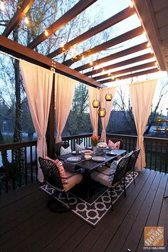 Jazz up your Trex Pergola with outdoor curtains. We love how they add a bit of privacy and a lot of elegance to this backyard deck. The lights strung on the pergola complete the picture. Outdoor Rooms, Outdoor Living, Outdoor Patios, Outdoor Kitchens, Outdoor Life, Indoor Outdoor, Deck Design, House Design, Pergola Designs