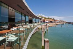 UK-based Guy Hollaway Architects has designed the Rocksalt Restaurant and Bar in Folkestone Harbour, Kent, England. It is the first restaurant venture for Restaurant Deals, Seafood Restaurant, Restaurant Design, Local Deals, Beach Gardens, British Isles, Architecture, Terrace, Guys