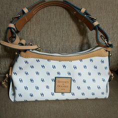 Authentic Dooney & Bourke Medium Hobo Bag NWOT New Never been used.Very nice.Comes with dust bag. Dooney & Bourke Bags Hobos