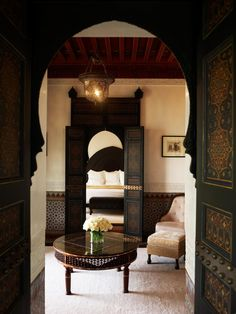 La Mamounia doorways and arches looking onto a modern, globally inspired bedroom.